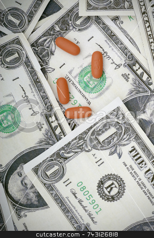Medicating the economy stock photo, Pills on us currency. Concept of medicating an injured economy, or concept of the cost of medication by Vince Clements
