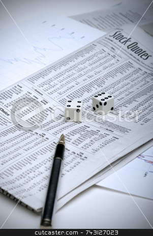 Gambling on the stock market stock photo, Rolling the dice on the stock market, with analysis sheets and a pen by Vince Clements