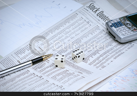 Gambling on stocks stock photo, Rolling the dice on the stock market, with analysis sheets and a cell phone to make the buy/sell call by Vince Clements