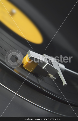 Vinyl record on turntable - tilted view stock photo, Tilted close up of headshell and stylus on a turntable by Vince Clements