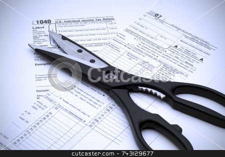 Cutting Taxes stock photo, Image of scissors and a cut up tax form indicating cutting taxes. by Vince Clements