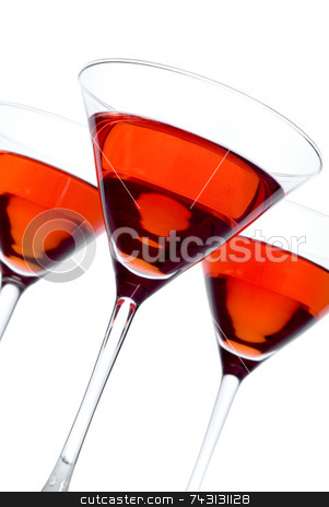 Strawberry Martini stock photo, Three backlit glasses of strawberry martini with shallow focus on the front glass. Tilted. Back 2 glasses are reflected in the stem of the front glass. by Vince Clements
