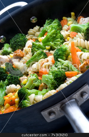 Cooking vegetables in a pan stock photo, Cooking vegetables in a pan by Vince Clements