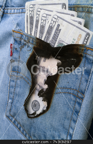 Burning a hole in my pocket 2 stock photo, Concept image of money burning a hole in a jeans pocket by Vince Clements