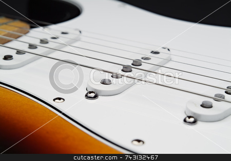 Electric guitar pickups and strings stock photo, Close up of electric guitar and strings from the pick's point of view by Vince Clements