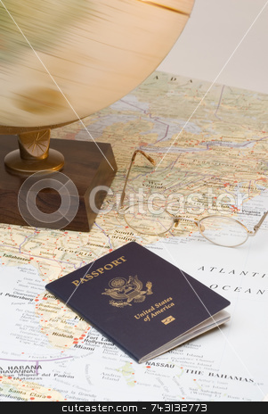 Travel around the globe stock photo, A US Passport and a spinning globe on a map. Planning a trip or vacation to somewhere. by Vince Clements