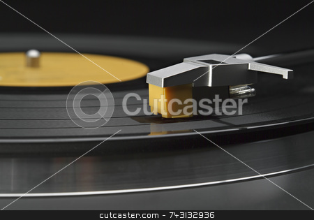 Vinyl record on turntable stock photo, Horizontal close up of headshell and stylus on a turntable by Vince Clements