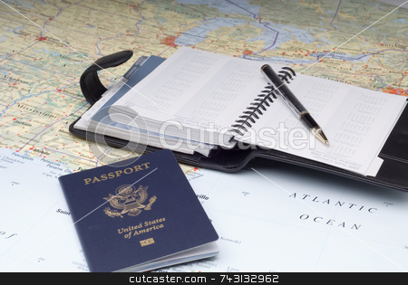 Travel Plans 3 stock photo, A US Passport and a day planner on a map.Possibly planning a cruise vacation by Vince Clements