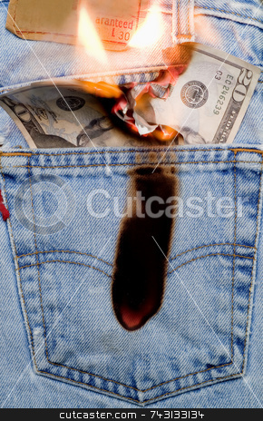 Burning a hole in my pocket 1 stock photo, Concept image of money burning a hole in a jeans pocket by Vince Clements