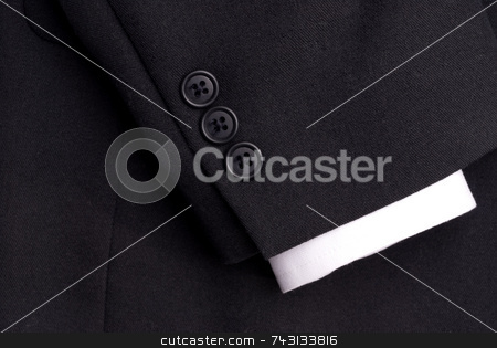 Closeup of a suit sleeve with a white cuff stock photo, Closeup of a suit sleeve with a white cuff by Vince Clements