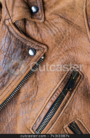 Brown leather jacket stock photo, Close-up of a worn brown leather jacket by Vince Clements