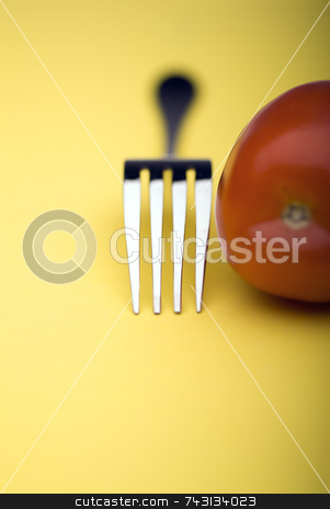 Fork and Tomato close up stock photo, Snappy image of a fork and a tomato on a bright yellow background by Vince Clements