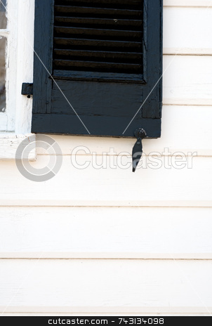 Old shutter stock photo, Old black shutter on an old white building by Vince Clements