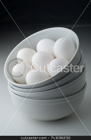 Raw eggs in stacked bowls stock photo, Raw eggs in stacked bowls by Vince Clements