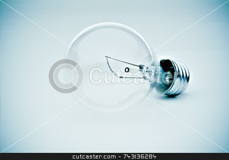 Light bulb in blue stock photo, Contrasty lightbulb in a subtle electric blue hue by Vince Clements