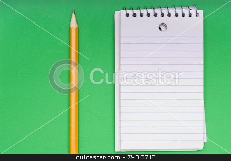 Pencil and blank notebook on green stock photo, A sharp pencil and a blank notebook on a bright green background. by Vince Clements