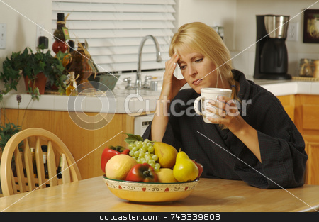 Woman Holding Head in Kitchen stock photo, Woman with hand on her head as she gazes in thought. Head ache? Depression? Loneliness? Versatile image. by Andy Dean