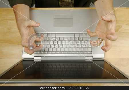 Man Using Laptop stock photo, Businessman shows his frustration while working on his laptop. by Andy Dean