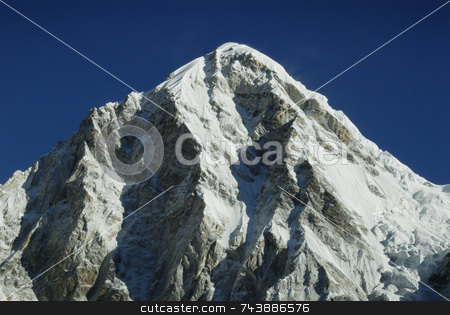 Pumori stock photo, Himalayan mountain Pumori in the Everest mountain range under a bright blue sky by A Cotton Photo