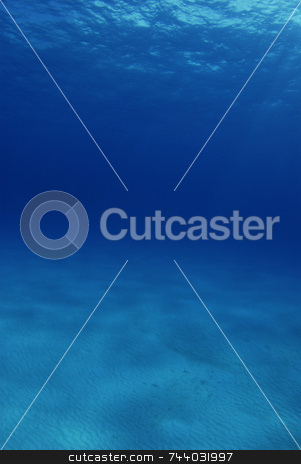 Underwater Background stock photo, Underwater tropical background of sand and sun rays. by A Cotton Photo