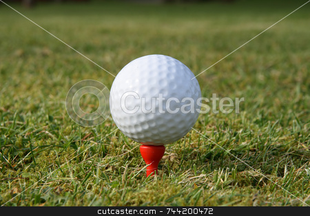 A golf ball on a red tee waiting to be hit. stock photo, A golf ball on a red tee waiting to be hit. by Stephen Rees