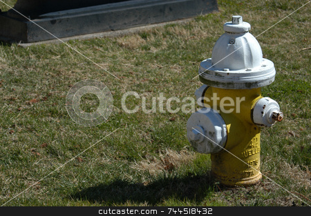 Fire Hydrant stock photo, A closeup of a yellow fire hydrant in a small city by Tim Markley