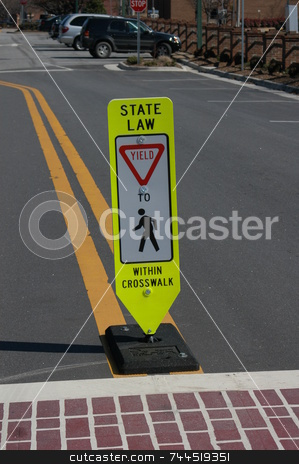 Crosswalk sign stock photo, A state law yield sign at a pedestrian crosswalk by Tim Markley