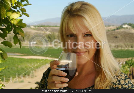 Attractive Woman Sips Wine stock photo, Attractive Woman Sips Wine at a Winery in the country. by Andy Dean
