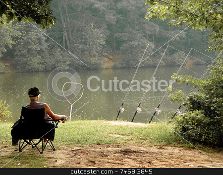 Fishing  stock photo, Fishing in the rain relaxing at the lake by Jack Schiffer