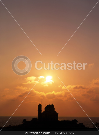 Church silhouette stock photo, The sun setting over a church in southern Cyprus by Paul Phillips