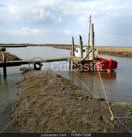 Fenland stock photo, A boat tied up on the fenland of East Anglia by Paul Phillips