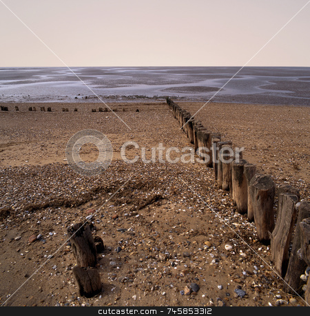 Erosion stock photo, Worn sea defences jutting out into sea by Paul Phillips