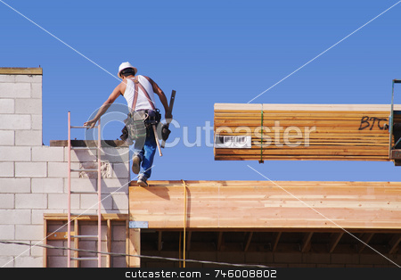 Carpenter Climbing Up Ladder stock photo, Carpenter climbing up ladder at a construction scene. by Andy Dean