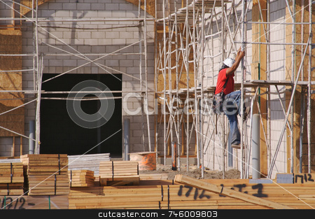 Carpenter Climbing Down Scaffolding stock photo, Carpenter climbing down scaffolding at a construction scene. by Andy Dean