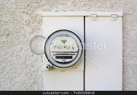 Electric Meter on Stucco Wall stock photo, Electric Meter on Outside Stucco Wall by Andy Dean