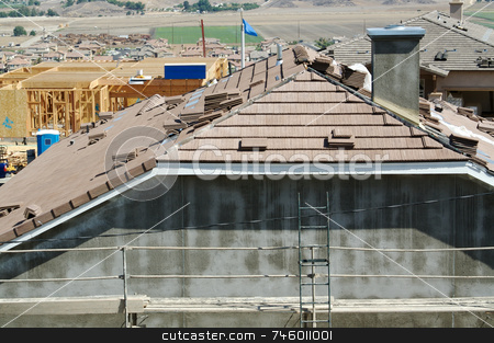 New Home Construction Site Roof stock photo, New Home Construction Site Roof and Tiles by Andy Dean