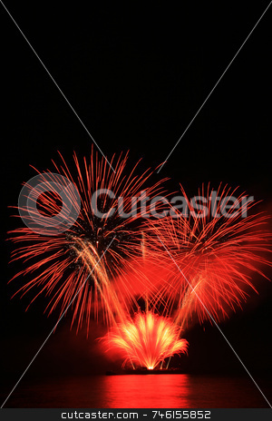 Red fireworks stock photo, Bright red fireworks against the dark sky by Jonas Marcos San Luis
