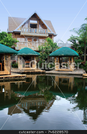 Floating nipa huts stock photo, Floating nipa huts with reflections on water by Jonas Marcos San Luis