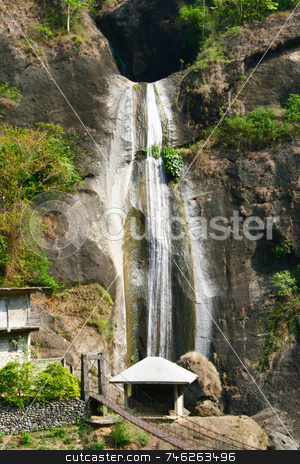 Cave waterfalls stock photo, Overlooking waterfalls coming from a cave by Jonas Marcos San Luis