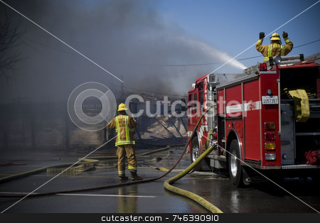 FIRE stock photo, San Bernardino firefighters attempt to extinguish a fire that started in a group of abandoned buildings in Colton, Calif., on March 22, 2008. No homes were threathened but all nearby roads were shut down until the fire was completely extinguished. (photo by Brett Benham/Brooks Institute  by Brett Benham