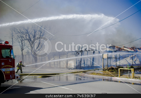 FIRE stock photo, A San Bernardino firefighter attempts to extinguish a fire that started in a group of abandoned buildings in Colton, Calif., on March 22, 2008. No homes were threathened but all nearby roads were shut down until the fire was completely extinguished. (photo by Brett Benham/Brooks Institute  by Brett Benham