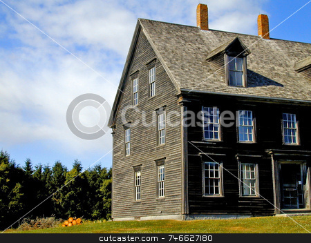 Early New England Home stock photo, Under a clouds and a blue sky, an early rural New England three story home by Tom and Beth Pulsipher