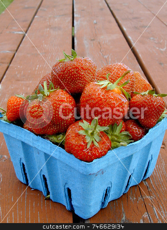 Farm Fresh Strawberries stock photo, Fresh, just-picked strawberries, displayed on a wood table by Tom and Beth Pulsipher