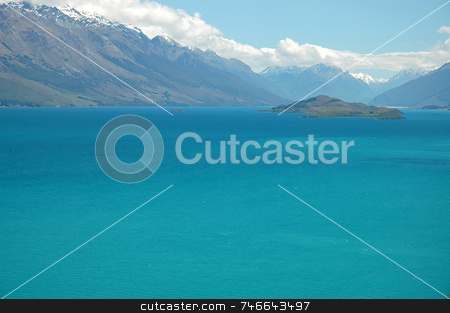 Blue Paradise - mountain lake stock photo, Vibrant turquoise colour lake surrounded by snow mountain peaks. Lake Whakatipu, Queenstown, New Zealand. by Irina Yun