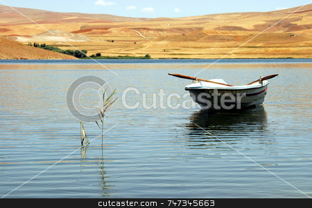 Boat On The Water stock photo, Boat on the water in turkish lake by Kobby Dagan
