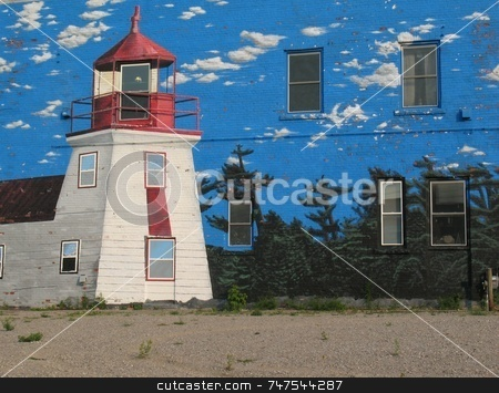 Mural on a Building stock photo, This image is on a mural of a lighthouse scene on the side of a building by Ray Carpenter
