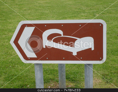 Motel sign stock photo, Sign showing way to hotel or motel. by Martin Crowdy