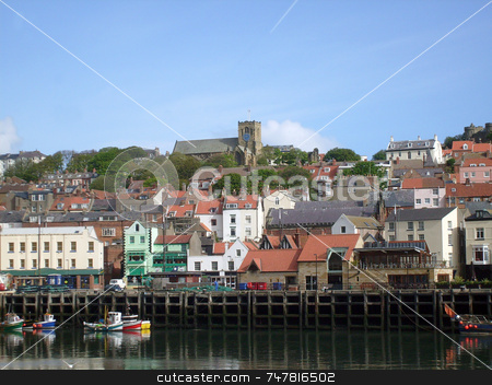 Fishing boats in harbor stock photo, Fishing boats moored in Scarborough harbour, England. by Martin Crowdy