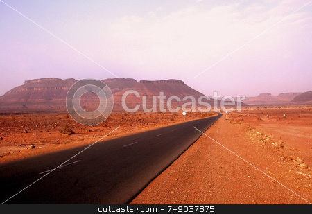 The Road stock photo, Empty road in the sahara desert in mauritania by Kobby Dagan