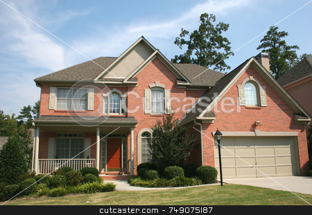 Brick House 6 stock photo, Nice brick house and blue sky by Darryl Brooks
